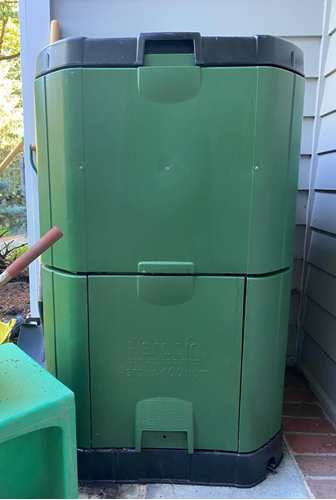 A picture containing green, bin, container  Description automatically generated